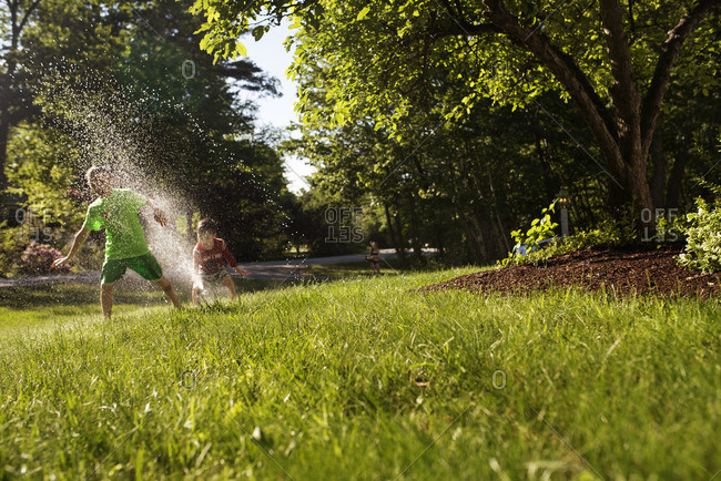 Children playing in a sprinkler