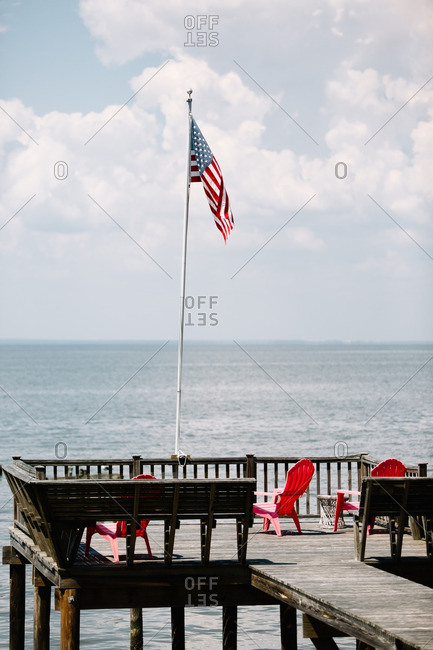 Wooden dock with American flag overlooking the ocean