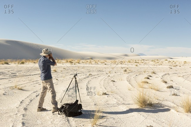 Photographer taking pictures at White Sands National Monument, Alamogordo, New Mexico