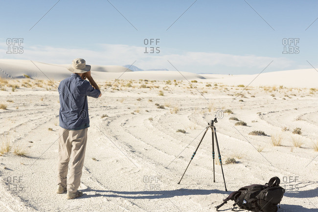Man taking pictures at White Sands National Monument, Alamogordo, New Mexico