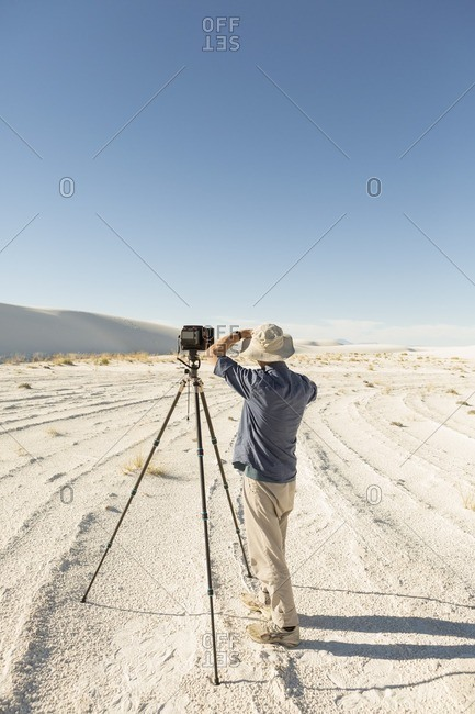 Photographer with his camera at White Sands National Monument, Alamogordo, New Mexico