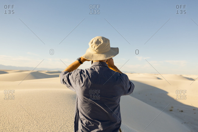 Photographer with camera at White Sands National Monument, Alamogordo, New Mexico