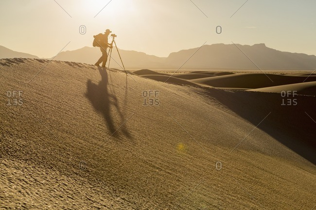 Photographer shooting from the top of a sand dune at White Sands National Monument, Alamogordo, New Mexico