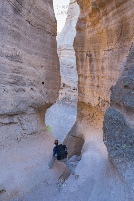 Man walking through slot canyons at Kasha-Katuwe Tent Rocks National Monument