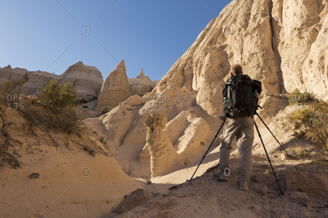 Man taking pictures of tent rocks at Kasha-Katuwe Tent Rocks National Monument