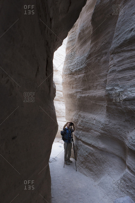 Man taking pictures at Kasha-Katuwe Tent Rocks National Monument