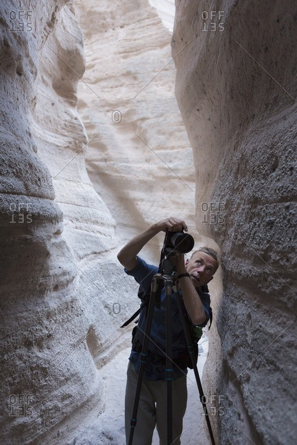 Photographer taking pictures of slot canyons at Kasha-Katuwe Tent Rocks National Monument
