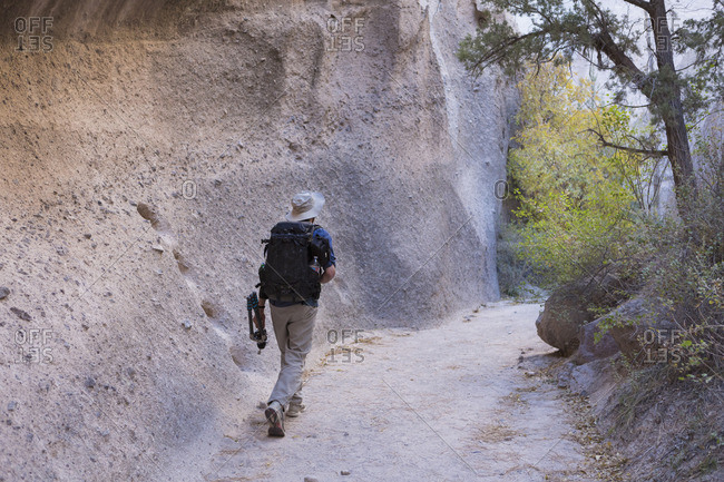 Photographer carrying equipment through Kasha-Katuwe Tent Rocks National Monument