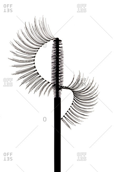 Fake lashes arranged on top of mascara wand
