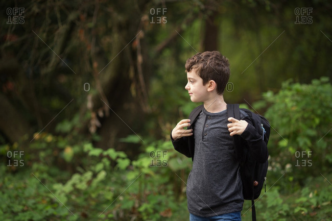 Boy in the country with a backpack