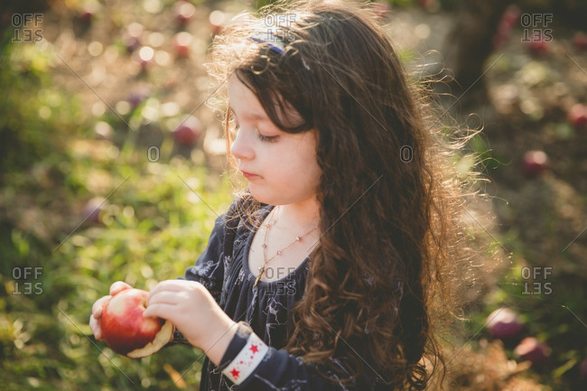 Girl with a fresh picked apple