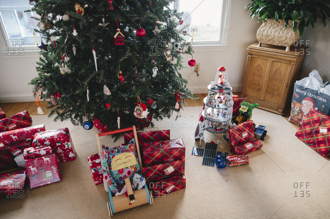 Piles of presents under a tree on Christmas morning