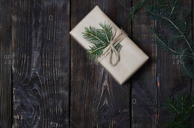Christmas gift box with fir sprigs and cone
