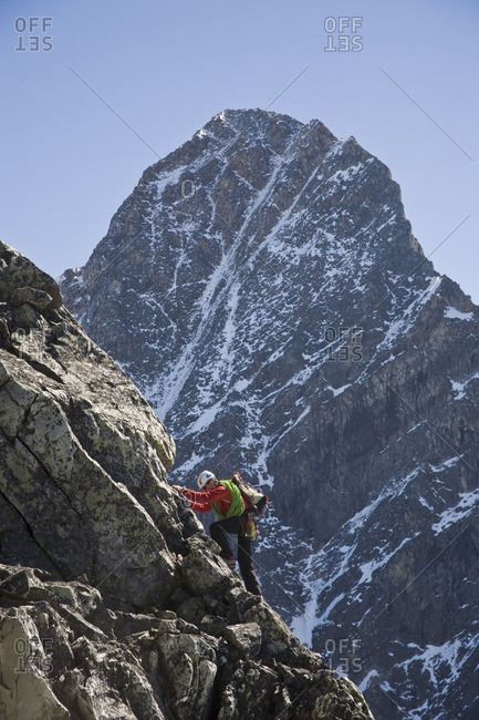 A mountain climber ascends Mt Uto in Roger's Pass,  Glacier National Park, BC