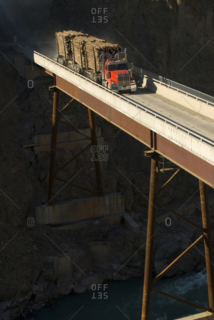 October 12, 2007:  A loaded logging truck crosses the Farwell Canyon bridge, Chilcotin River, British Columbia, Canada