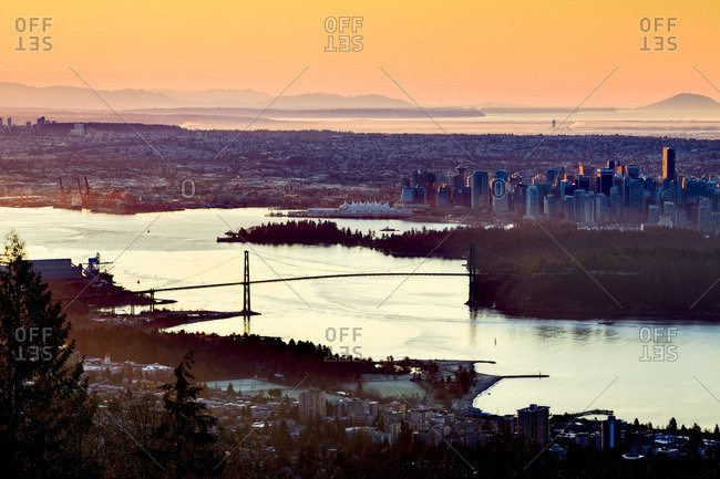 The Vancouver skyline with the Lion's Gate Bridge and Burrard Inlet at dawn. Vancouver British Columbia Canada