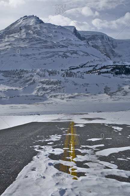 Deserted snow-covered highway into the Athabasca Glacier, Jasper National Park, Alberta, Canada.