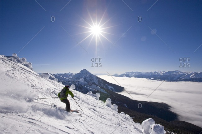 Young man skiing at Revelstoke Mountain Resort, BC, Canada. (model release #08114)