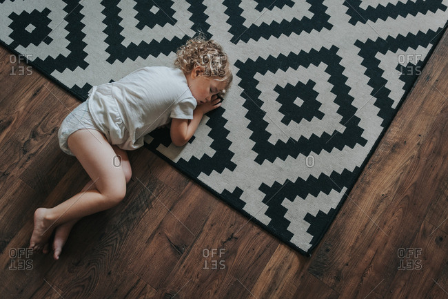 Toddler girl asleep on floor