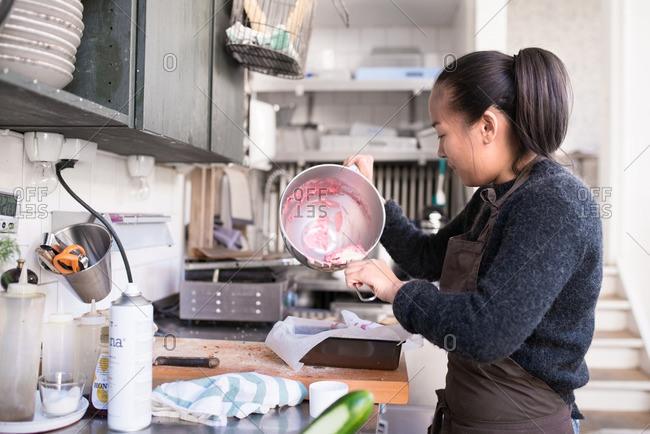 Woman in cafe preparing batter