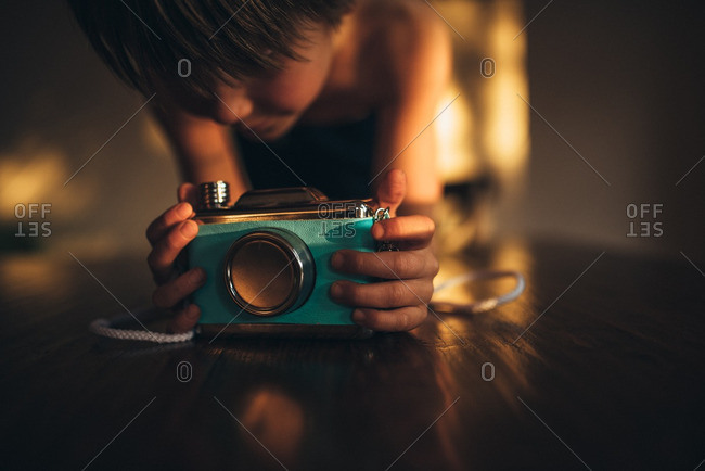Boy looking at blue camera
