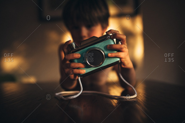 Boy playing with blue camera