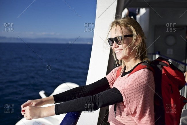 Backpacker travelling on a boat