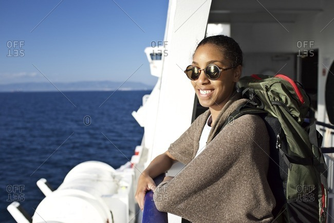 Young woman travelling on a boat