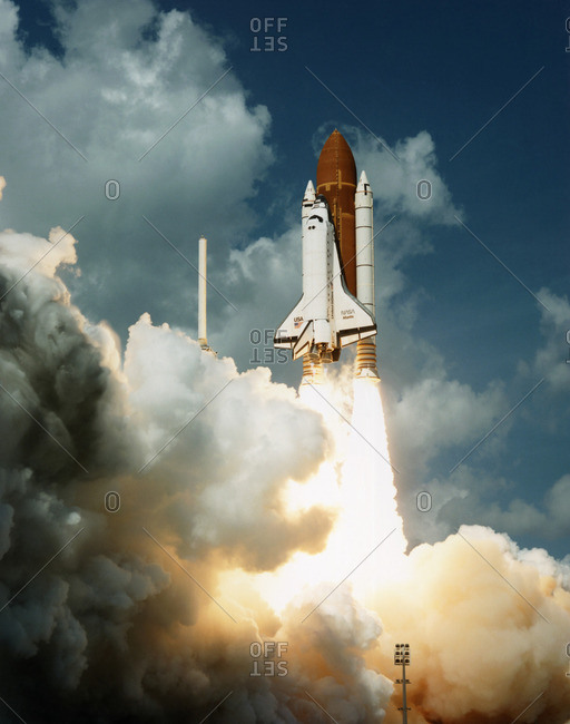 Shuttle Atlantis about to clear the tower moments after launch on Mission STS-34 on 18 October 1989 from the Kennedy Space Centre, Florida