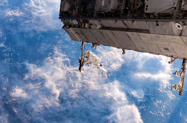Astronaut Curbeam performing spacewalk