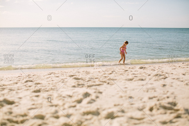 Girl on the shore of a beach