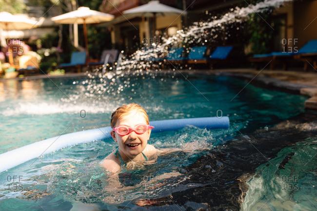 Little girl in a resort swimming pool