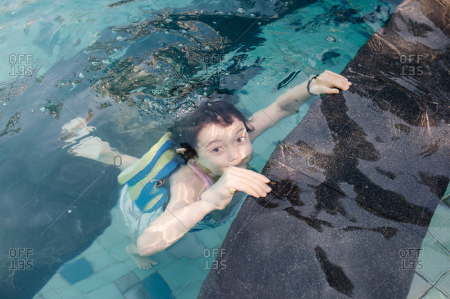 Little girl underwater in a swimming pool