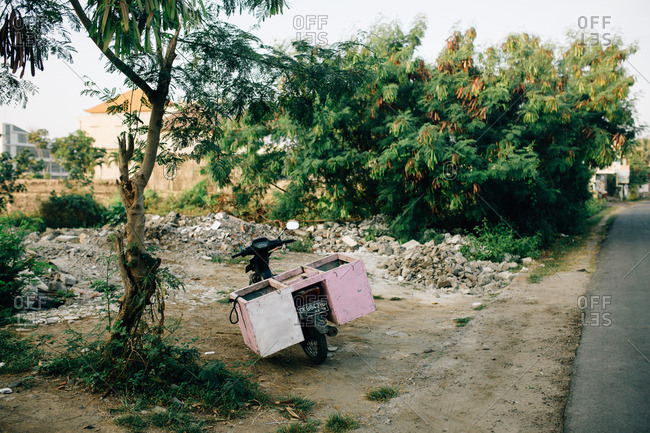 Canguu, Bali, Indonesia - September 1, 2016: Bali, Indonesia - September 1, 2016: Moped parked on the side of a road