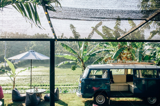 Canguu, Bali, Indonesia - September 2, 2016: Bali, Indonesia - September 2, 2016: Retro van parked near an outdoor seating area at a resort