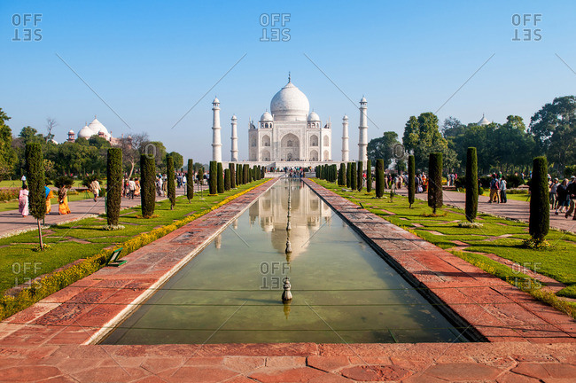 Agra, India - March 13, 2014: The reflecting pool in front of the Taj Mahal, Agra, India