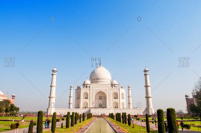 Agra, India - March 13, 2014: Taj Mahal and fountain in Agra, India