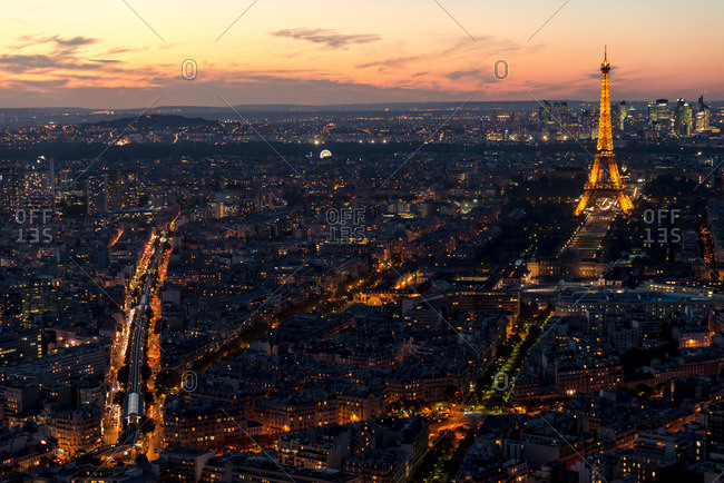 Paris, France - October 4, 2016: View of Paris and the Eiffel Tower illuminated at dusk