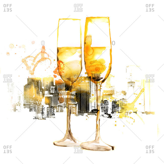 Champagne glasses in front of city background