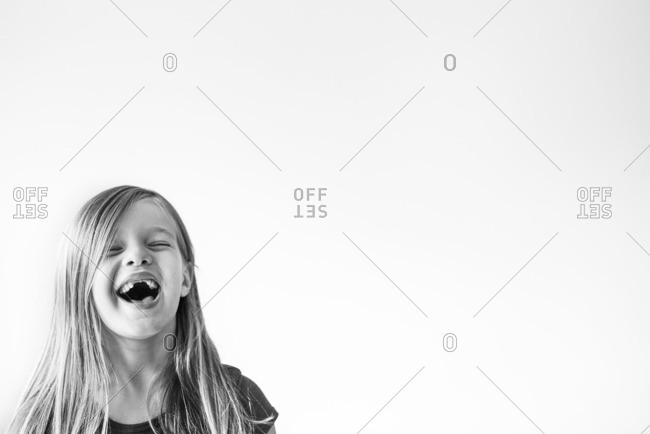 Portrait of a laughing girl with missing front teeth