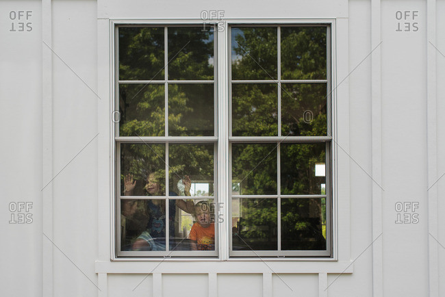 Children with their faces pressed against the window