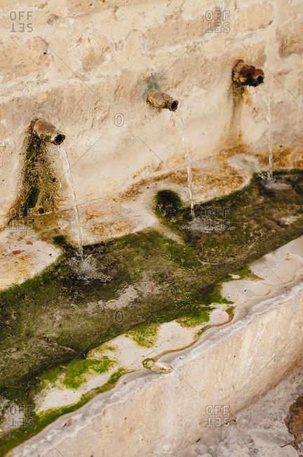 Detail of ancient water fountains in Horche, Spain