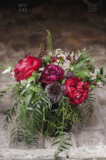 Bridal bouquet with red and purple flowers