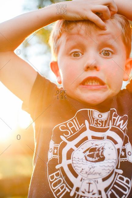 Boy making shocked face in sunlight