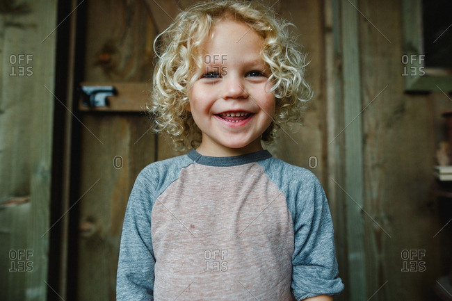 Delighted boy with blonde curls