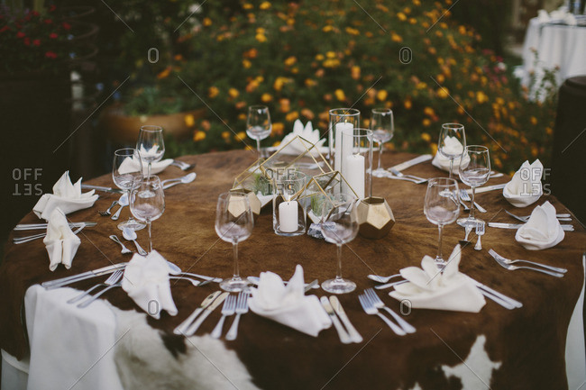 Geometric table setting with small cacti and candles