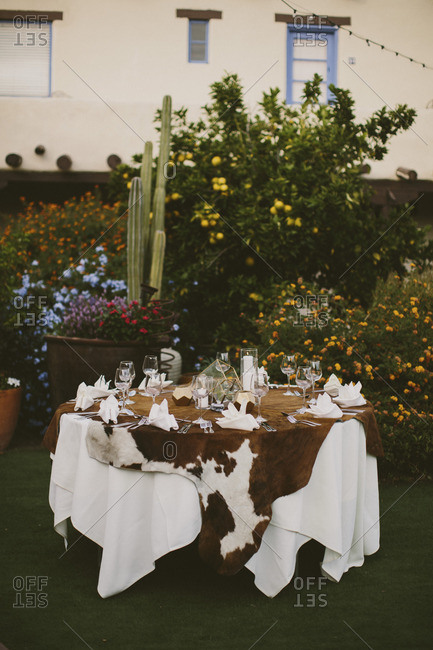 Table setting with a cow hide as table cloth