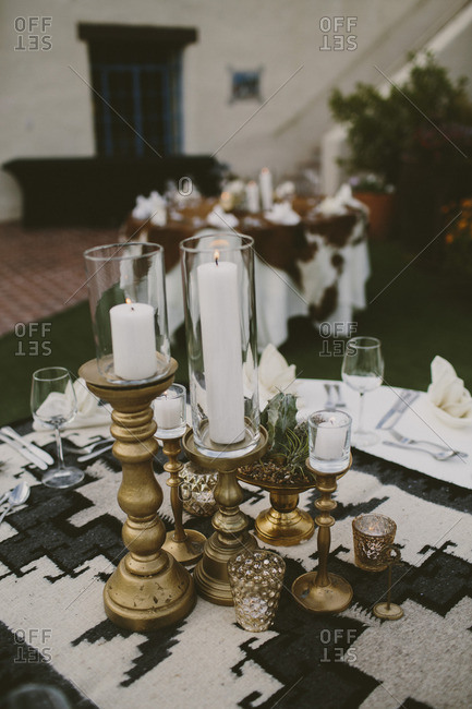 Close up of gold candles on a table setting
