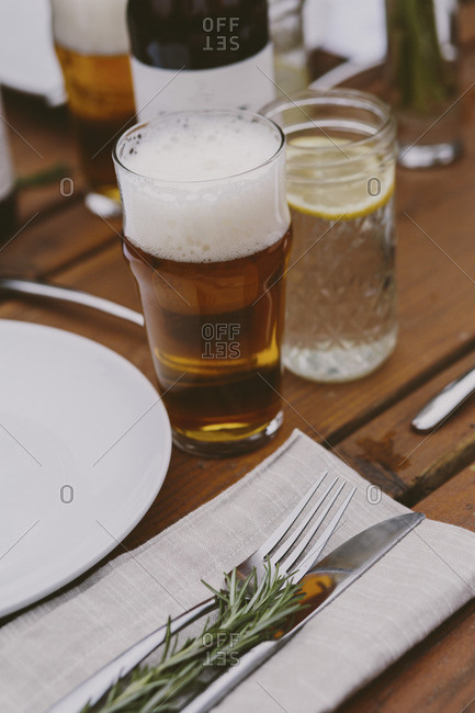 A glass of beer at table setting