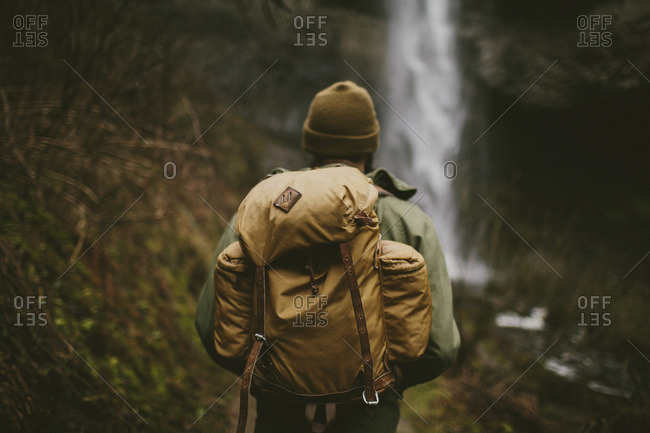 Hiker carrying backpack